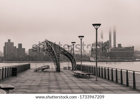 A beautiful shot of North 5th Street Pier and Park in Brooklyn, New York City with monochromatic tones