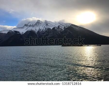A beautiful sky, a beautiful lake, beautiful mountains, a beautiful day.