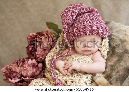 A beautiful sleeping baby girl wearing a hat with a vintage look, soft focus