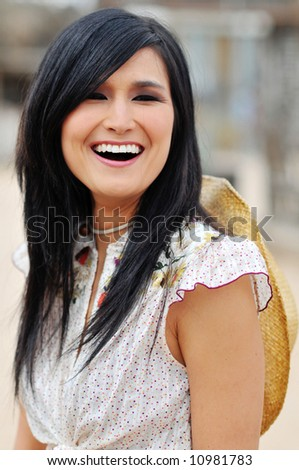 A beautiful smiling asian american woman capturing her happy expression