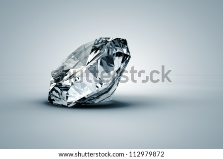 A beautiful sparkling diamond on a light surface