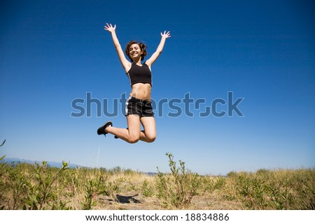 A beautiful sporty caucasian girl jumping for joy