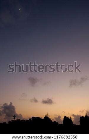 A beautiful sunrise creating a unique tone shading of the sky #1176682558