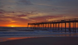 A beautiful sunrise in Ocean City, MD.  The beach is almost deserted early in the morning which makes for a serene and wonderful experience while photographing the sunrise.