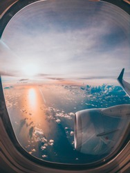 a beautiful sunrise looked in a plane window in the middle of the fligth