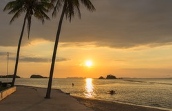 A beautiful sunset, on a quiet beach in Saladan, Ko Lanta, looking out to Ko Phi Phi during the Covid19 outbreak.