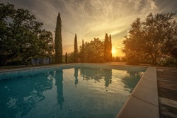 A beautiful sunset on a swimming pool in the south of Tuscany, between the provinces of Grosseto and Siena.