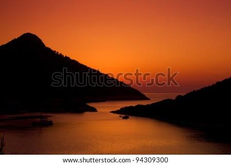 A beautiful sunset on bay. Island in Croatia during summer.