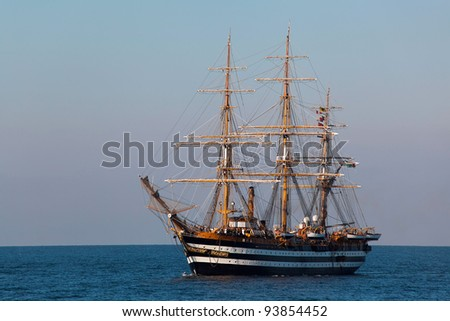 A beautiful three-masted sailboat in the open sea