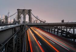 A beautiful timelapse shot of car lights near Brooklyn Bridge in New York, USA