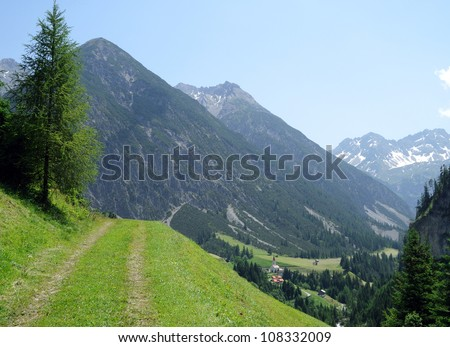 a beautiful trekking path in the austrian alps