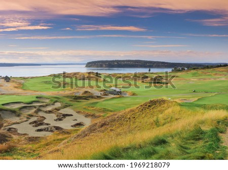 a beautiful view of a golf course at sunset Stock photo ©