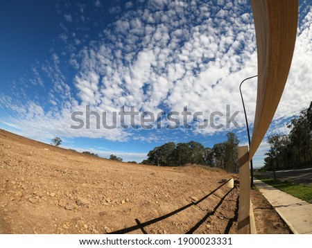 A beautiful view of a road with a wooden fence in Schofield, New South Wales, Australia Stockfoto ©