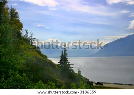 A beautiful view of forests and mountains surrounding Turnagain Arm around the Kenai Peninsula of Alaska.