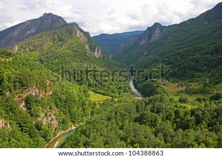 A beautiful view of the Canyon of the Tara river with a settlement at the bottom and some lines crossing the canyon. Montenegro.
