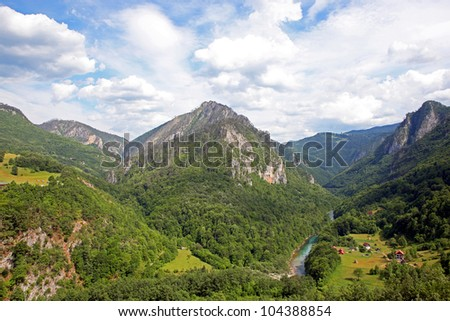 A beautiful view of the Canyon of the Tara river with a settlement at the bottom. Montenegro.