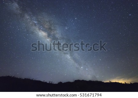 A beautiful view of the Milky Way in Sabah Borneo. Long exposure photograph with grain. Image contain certain grain or noise and soft focus.