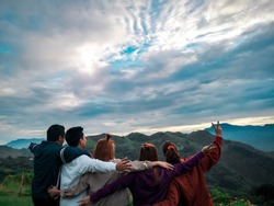 A beautiful view of the mountain. Treasure mountain in Tanay Rizal Philippines. Friends enjoyijng the magnificent view of the sierra madre mountain.