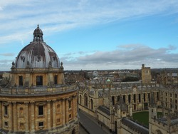 A beautiful view of the Oxford University City, viewed from the top tower of St Mary's Church. Radcliffe Camera and Souls Colleges, Oxford University, UK.