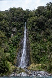 A beautiful view of the Thunder Creek Falls located in New Zealand