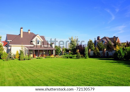 a beautiful village house with its garden - stock photo