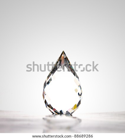 a beautiful water drop-shape crystal, highlight at the middle of the object - stock photo