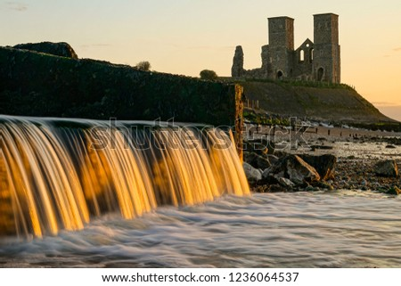 A beautiful waterfall during sunset at Reculver towers in England.