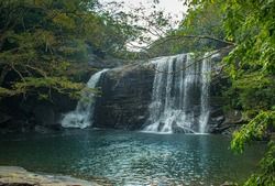 A beautiful waterfall in the middle of the forest located in Srilanka