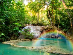 A beautiful waterfall with rainbow in deep forest of Erawan National Park in Kanchanaburi Province , Thailand