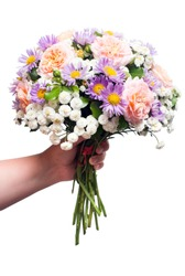 A beautiful wedding bouquet of flowers roses, chamomile and decorative yarrow is in the hands of a girl. Love and relationships.