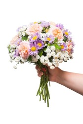 A beautiful wedding bouquet of flowers roses, chamomile and decorative yarrow is in the hands of a girl. Love and relationships. Flora. Spring, summer. St. Valentine's Day. Easter. Flat, top. Object