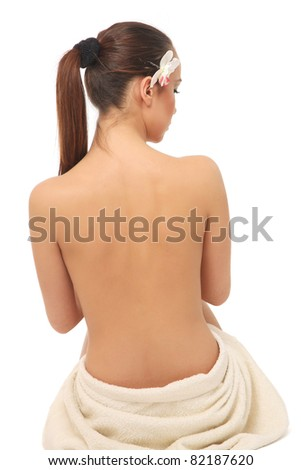 A beautiful woman, back view, isolated on white background