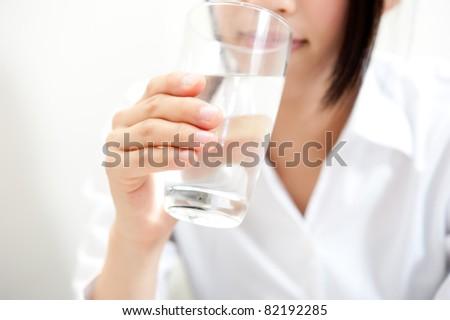 a beautiful woman drinking - Shutterstock ID 82192285