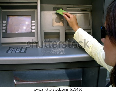 a beautiful woman getting money with her credit card at the ATM,