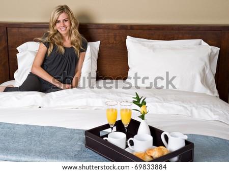 A beautiful woman has breakfast in bed