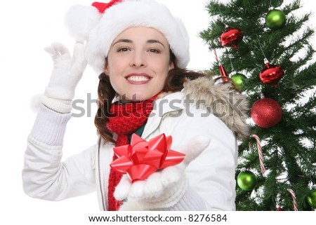 A beautiful woman holding a bow at Christmas