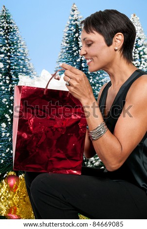 A beautiful woman holding a Christmas present