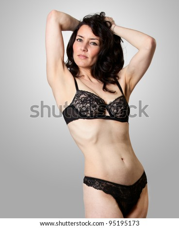 A beautiful woman in lingerie posing in studio