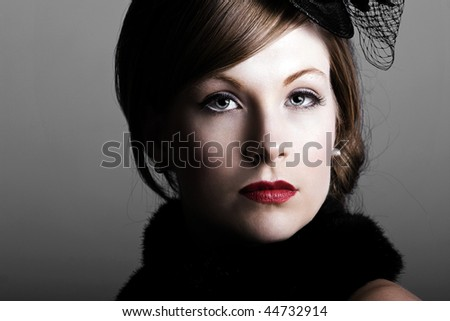 a beautiful woman in the 1930s style of dress in a dramatic low key setting