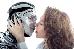 A beautiful woman kissing male robot with love. Two faces very close to each other. Relationship between artificial cyborg and real girl. Closeup portrait of futuristic couple.