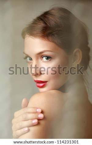 A beautiful woman portrait isolated on grey background