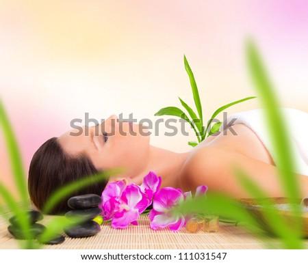 A beautiful woman relaxing in spa