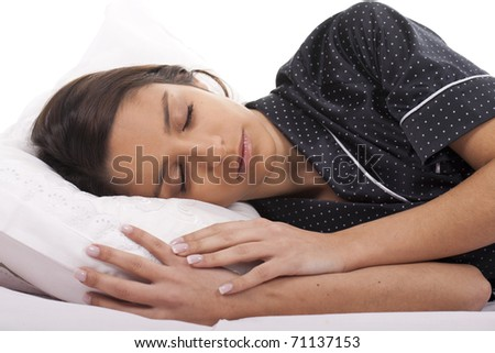 a beautiful woman resting in bed and sleeping