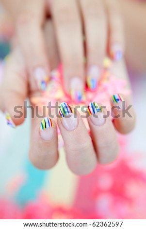 A beautiful woman's hand with bright nail polish
