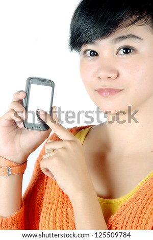 a beautiful woman shows a touch screen mobile phone in his hand isolated on white background
