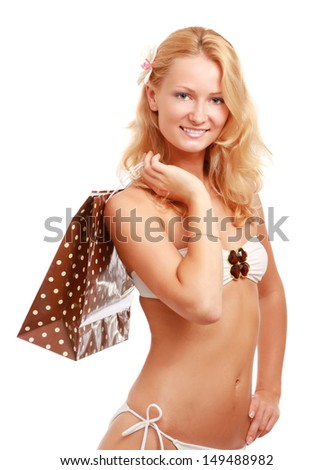 A beautiful woman wearing a swimsuit, holding a shopping bag, isolated on white - stock photo