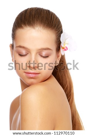 A beautiful woman with a flower in her hair, isolated on white background.Side view - stock photo