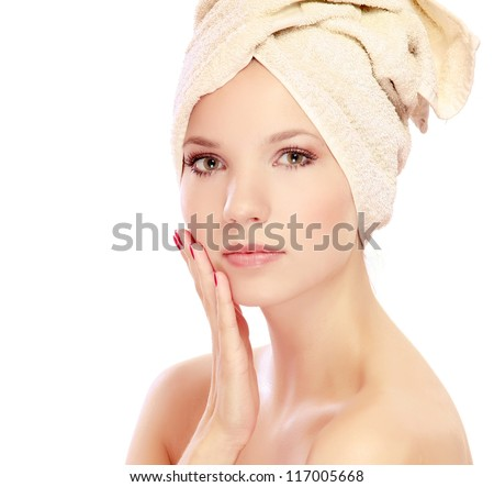 A beautiful woman with a towel on her head, isolated on white - stock photo