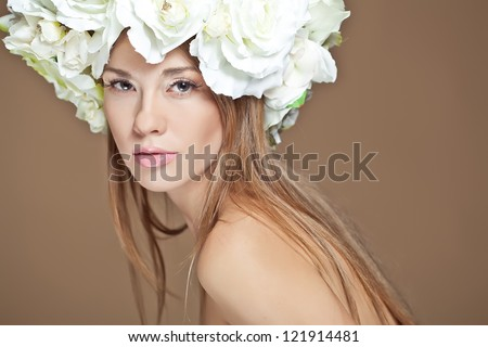 A beautiful woman with a wreath of flowers.