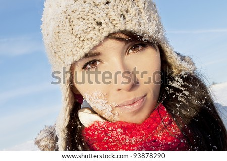 a beautiful woman with snowflakes on her face